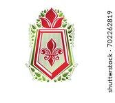 vintage heraldic emblem created ... | Shutterstock . vector #702262819
