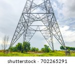 high voltage tower and... | Shutterstock . vector #702265291
