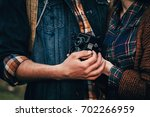 hands of the couple together... | Shutterstock . vector #702266959
