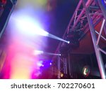 light effects at party from a dj | Shutterstock . vector #702270601