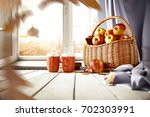 autumn window with wooden table ... | Shutterstock . vector #702303991