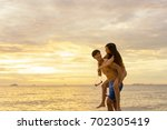 couple spend time on the beach | Shutterstock . vector #702305419
