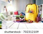 school supplies on a wooden...   Shutterstock . vector #702312109