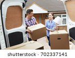 young couple moving in to new... | Shutterstock . vector #702337141