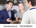 meeting of restaurant team in... | Shutterstock . vector #702340834