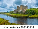 dunvegan castle on the isle of... | Shutterstock . vector #702345139
