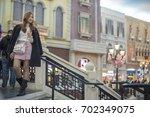 thai girls go sightseeing and... | Shutterstock . vector #702349075