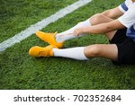 young soccer player tying... | Shutterstock . vector #702352684