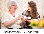 cheerful granddaughter and her...   Shutterstock . vector #702358981