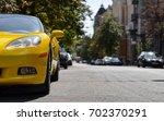 front of yellow sport car | Shutterstock . vector #702370291
