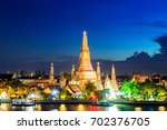 wat arun temple at sunset... | Shutterstock . vector #702376705