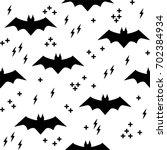 vector pattern with bats.... | Shutterstock .eps vector #702384934