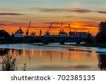 aberdeen harbour  scotland ... | Shutterstock . vector #702385135
