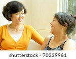 Family closeness of asian ethnic mother and daughter - stock photo