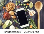 kitchen table with ingredients  ...   Shutterstock . vector #702401755