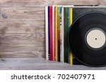 retro styled image of a... | Shutterstock . vector #702407971