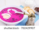 cold beet soup in plate on... | Shutterstock . vector #702429907