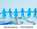 family doctor. paper man and... | Shutterstock . vector #702432844