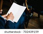 a man writes a pen on a blank...   Shutterstock . vector #702439159