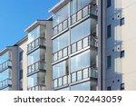 balconies at apartment...   Shutterstock . vector #702443059