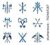 vintage weapon emblems set.... | Shutterstock . vector #702465187