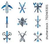 vintage weapon emblems set.... | Shutterstock . vector #702465301