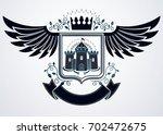 vintage heraldic coat of arms... | Shutterstock . vector #702472675