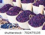 dry herb hibiscus for tea in... | Shutterstock . vector #702475135