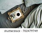 morning coffee on golden... | Shutterstock . vector #702479749