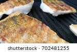 fish fillet bbq close up | Shutterstock . vector #702481255