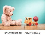 retro teddy bear sitting alone... | Shutterstock . vector #702495619