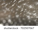 bokeh light beige abstract... | Shutterstock . vector #702507067