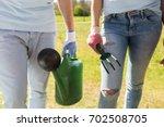 volunteering  people and... | Shutterstock . vector #702508705