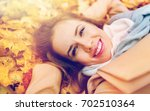 season and people concept  ... | Shutterstock . vector #702510364