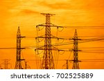 transmission line tower | Shutterstock . vector #702525889