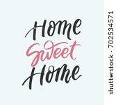 home sweet home lettering.... | Shutterstock .eps vector #702534571