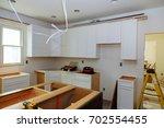 installation of kitchen... | Shutterstock . vector #702554455