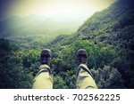 hiker legs on the top of... | Shutterstock . vector #702562225