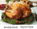 composition with whole roasted... | Shutterstock . vector #702577555