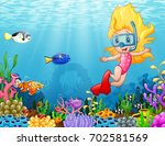 little girl diving in the sea | Shutterstock . vector #702581569