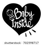 english phrase for baby inside...   Shutterstock .eps vector #702598717