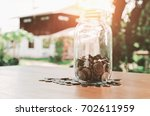 saving money in jar glass and... | Shutterstock . vector #702611959