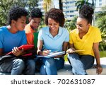 group of learning african... | Shutterstock . vector #702631087