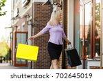 side view of happy woman window ...   Shutterstock . vector #702645019