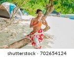 traveler asian woman in bikini... | Shutterstock . vector #702654124