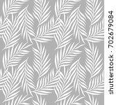 palm tree leaves seamless... | Shutterstock .eps vector #702679084