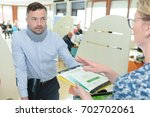 man wearing neck brace claiming ... | Shutterstock . vector #702702061
