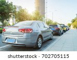 cars in the city  parking at... | Shutterstock . vector #702705115