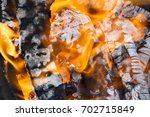 charcoal burning in bbq or in... | Shutterstock . vector #702715849