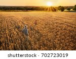 top view. a farmer and his son... | Shutterstock . vector #702723019